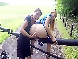 Lesbian couple enjoying some outdoor fingering