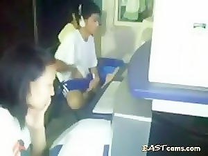 Asian bating in public pc rental store