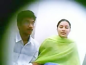 indian couple caught at computer shop cubicle